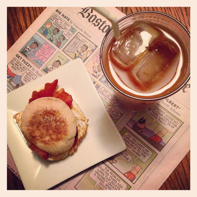 First breakfast: Egg sandwich made with bacon and Light Creamy Swiss from @thelaughingcowusa + iced coffee with @so_delicious eggnog! #myfav #ad #breakfast #firstbreakfast #eggsandwich #icedcoffee #sundayglobe #bostonglobe #myffmeal #thelaughingcow #monday #mondaymorning #thefunnies #bacon #englishmuffin #yum #eggnog