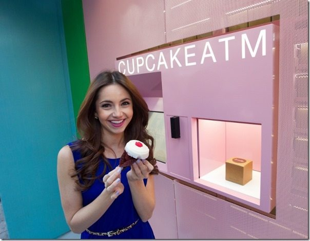 NEW YORK - March 24,  2014. For Pulse/News. New York's first Cupcake ATM by the Sprinkles cupcake store is at 780 Lexington Avenue. Model Alexandra enjoys a cupcake from the machine.(photo by Tamara Beckwith/NY POST)