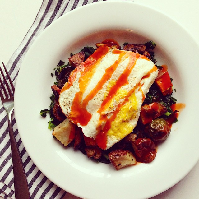 Threw this lunch together in 5 minutes thanks to some Sunday food prep: Collard greens with roasted sweet and red potatoes, Brussels sprouts, mushrooms, a fried egg, and buffalo sauce! #lunch #sogood #throwtogethermeal #5minutemeal #myffmeal #fitfluential #buffalosauce #roastedveggies #friedegg #eat #fitmom #fiteats #sundayprep #sundayfoodprep #foodprep