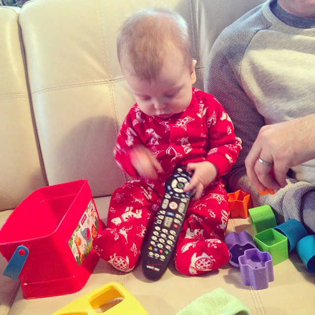 So many toys... loves the remote. #christmas #junebaby #remotecontrol