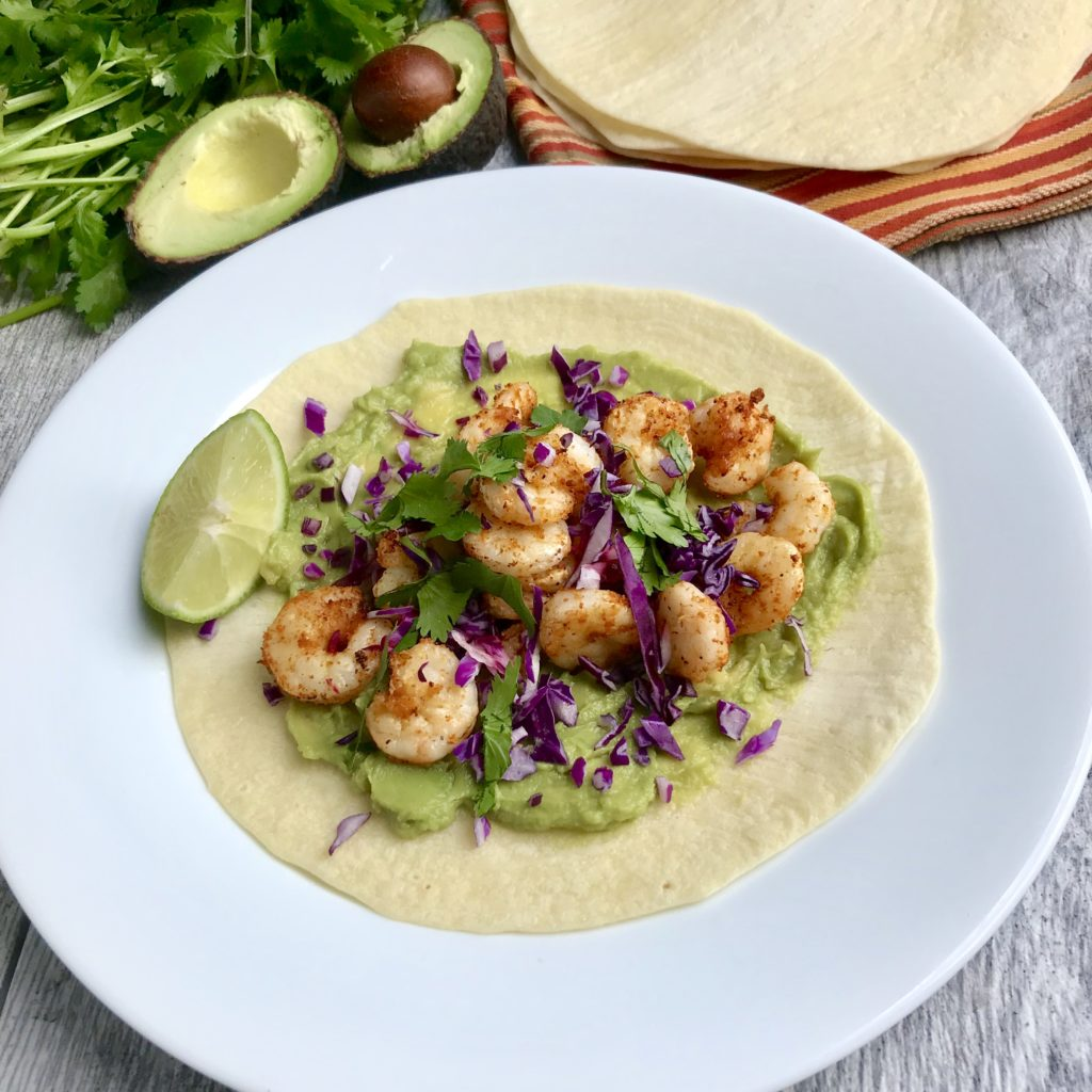 Overhead shot of Air Fryer Shrimp Taco on a round white plate served with a slice of lime.