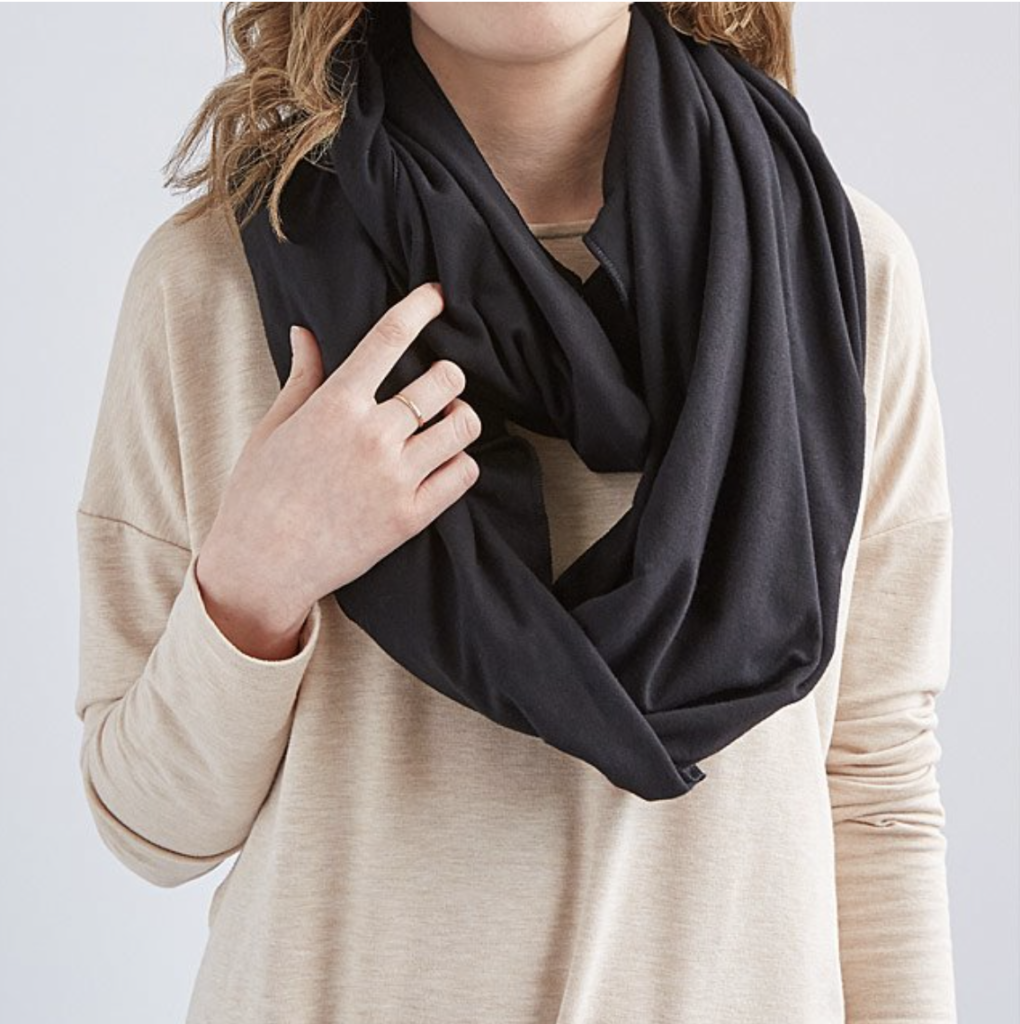 Soft, warm, and stylish infinity scarf hides an inflatable pillow to make travel more comfortable.