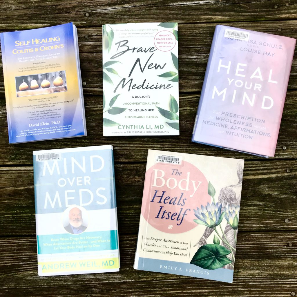An overhead image of self-healing and mind-body books