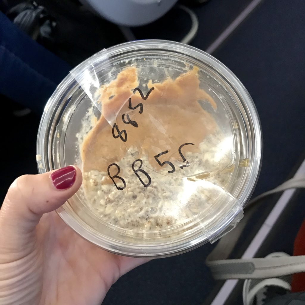 overnight oats on a plane inside a plastic container; Meal Prep Hacks for a Long Flight